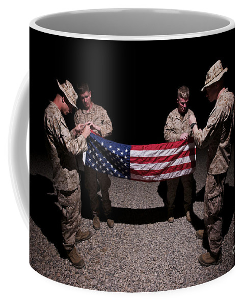Us Flag Coffee Mug featuring the photograph U.s. Marines Fold The American Flag by Terry Moore