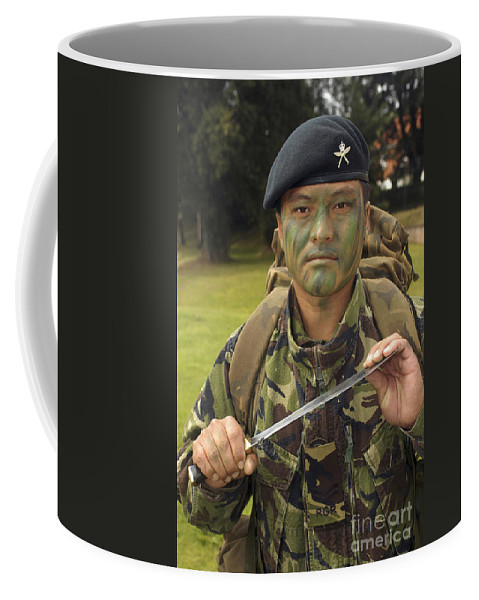 Beret Coffee Mug featuring the photograph A British Army Gurkha by Andrew Chittock