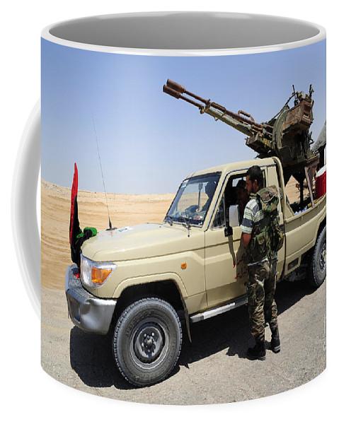 Ajadabiya Coffee Mug featuring the photograph A Free Libyan Army Pickup Truck by Andrew Chittock