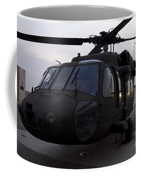 Aviation Coffee Mug featuring the photograph A Uh-60 Black Hawk Helicopter by Terry Moore