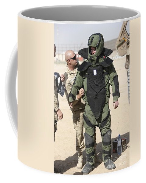Afghanistan Coffee Mug featuring the photograph A U.s. Marine Gets Suited by Terry Moore