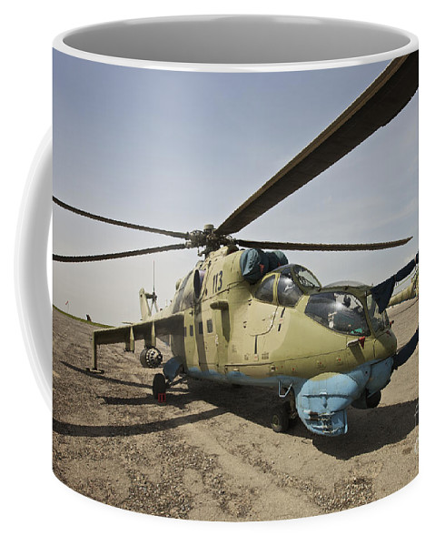 Attack Helicopters Coffee Mug featuring the photograph An Mi-35 Attack Helicopter At Kunduz by Terry Moore