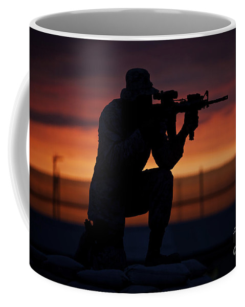 M16 Coffee Mug featuring the photograph Silhouette Of A U.s Marine On A Bunker by Terry Moore