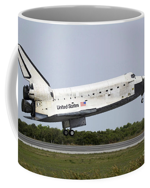 Tarmac Coffee Mug featuring the photograph Space Shuttle Discovery Approaches by Stocktrek Images