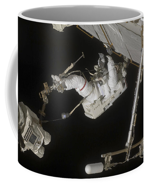 Sts-127 Coffee Mug featuring the photograph Astronaut Working On The International by Stocktrek Images