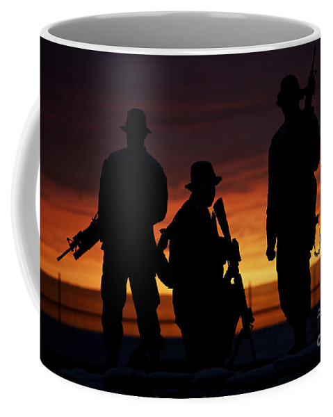 M16 Coffee Mug featuring the photograph Silhouette Of U.s Marines On A Bunker by Terry Moore