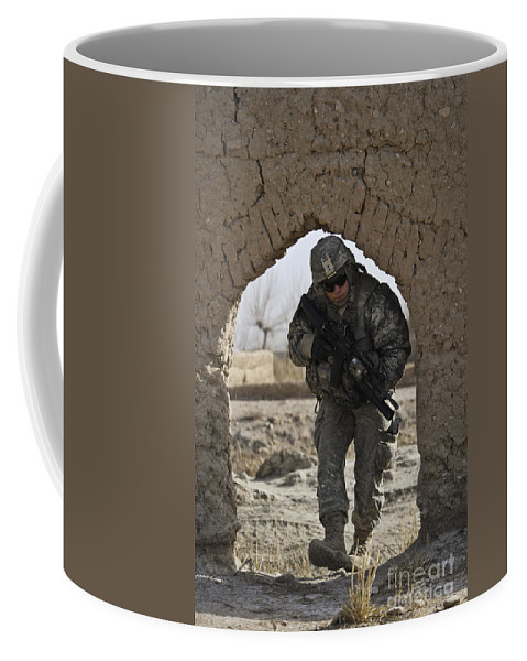 Afghanistan Coffee Mug featuring the photograph U.s. Army Soldier Provides Security by Stocktrek Images