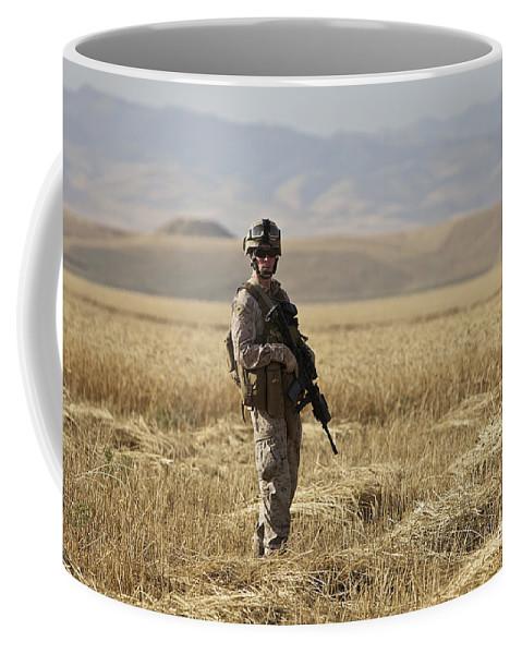 Patrol Coffee Mug featuring the photograph U.s. Marine Patrols A Wadi Near Kunduz by Terry Moore