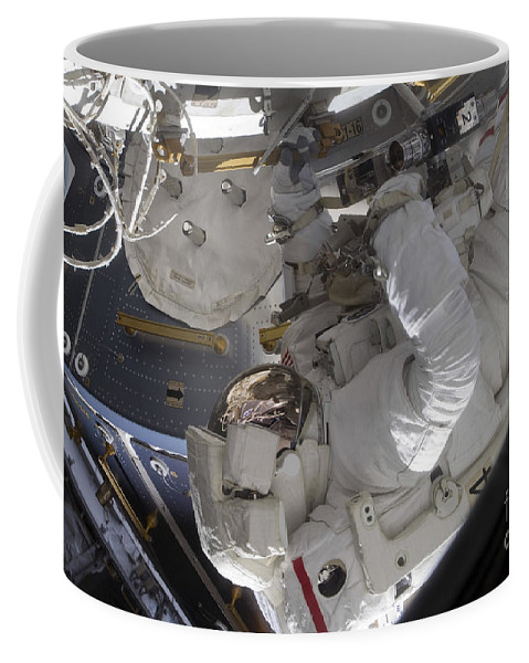 Sts-128 Coffee Mug featuring the photograph Astronaut Working On The International by Stocktrek Images