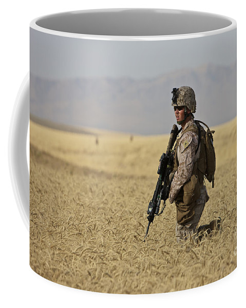 Afghanistan Coffee Mug featuring the photograph U.s. Marine Patrols A Wadi Near Kunduz by Terry Moore