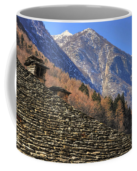 Roof Coffee Mug featuring the photograph Snow-capped Mountain by Mats Silvan