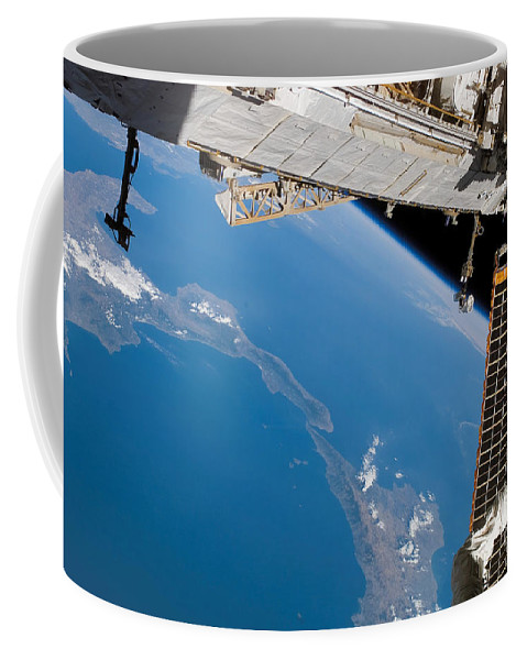 Color Image Coffee Mug featuring the photograph International Space Station by Stocktrek Images