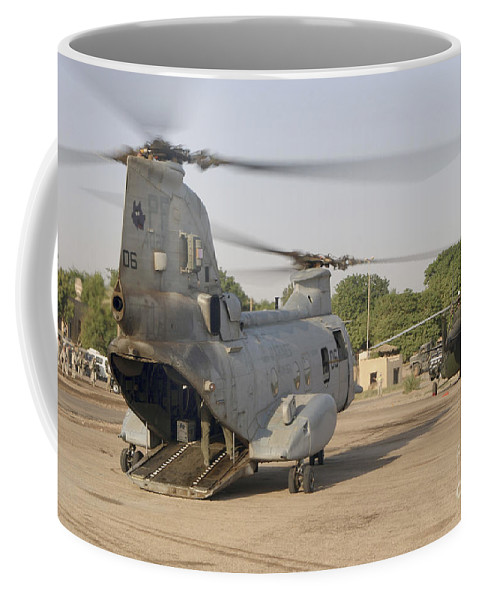 Horizontal Coffee Mug featuring the photograph A Ch-46 Sea Knight And Mi-8 Helicopter by Stocktrek Images