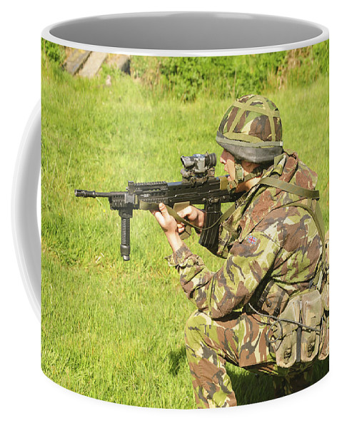 Combat Uniforms Coffee Mug featuring the photograph A Coldstream Guard Training In Scotland by Andrew Chittock