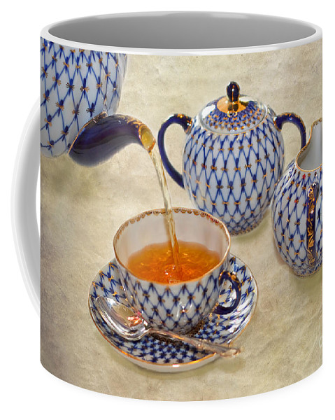 Tea Coffee Mug featuring the photograph A Cup Of Tea Tea Being Poured Into A China Cup by Louise Heusinkveld