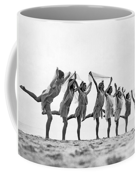1035-11355 Coffee Mug featuring the photograph A Dance To The Morning Sun by Underwood Archives