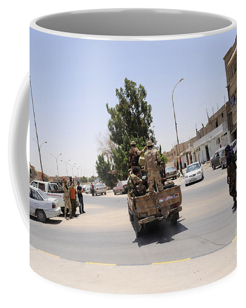Libya Coffee Mug featuring the photograph A Free Libyan Army Pickup Truck by Andrew Chittock