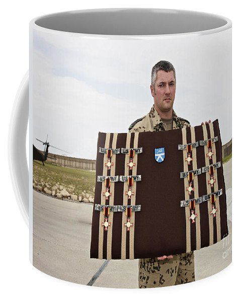 Afghanistan Coffee Mug featuring the photograph A German Soldier Holds A Display by Terry Moore