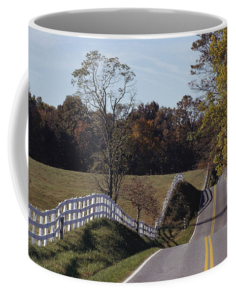 Fences Coffee Mug featuring the photograph A Hilly Country Road Passes A Fenced by Medford Taylor
