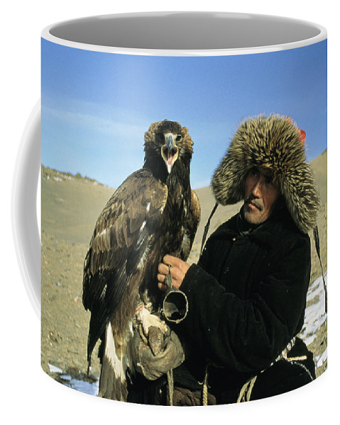Commonwealth Of Independent States Coffee Mug featuring the photograph A Kazakh Eagle Hunter Poses by Ed George