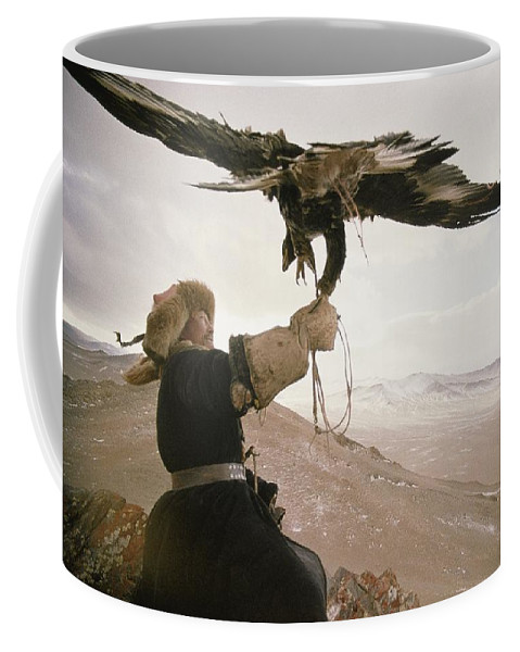 Color Image Coffee Mug featuring the photograph A Kazakh Hunter Strains To Support by David Edwards