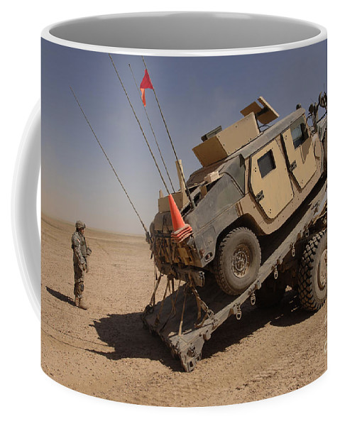 Horizontal Coffee Mug featuring the photograph A M1114 Armored Vehicle Is Unloaded by Stocktrek Images
