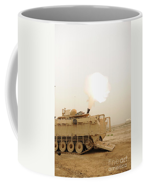 Iraq Coffee Mug featuring the photograph A M120 Mortar System Is Fired by Stocktrek Images