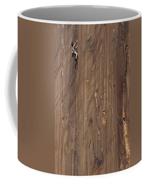 Sports Coffee Mug featuring the photograph A Man Climbing The Concepcion Crack by Jimmy Chin