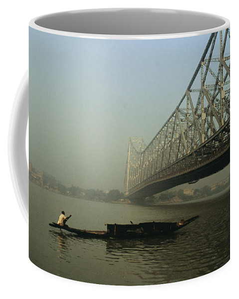 Asia Coffee Mug featuring the photograph A Man Guides A Boat Under A Bridge by Ed George