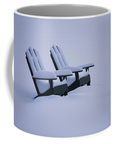 Furnishings Coffee Mug featuring the photograph A Pair Of Adirondack Chairs In The Snow by Michael Melford