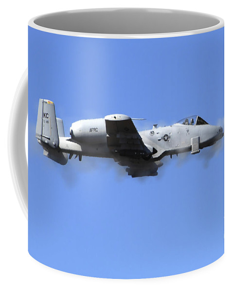 Horizontal Coffee Mug featuring the photograph A Pilot In An A-10 Thunderbolt II Fires by Stocktrek Images