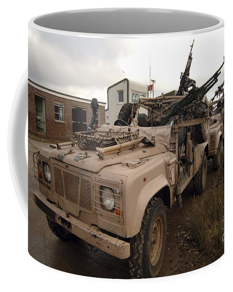 Foreign Military Coffee Mug featuring the photograph A Pink Panther Land Rover by Andrew Chittock