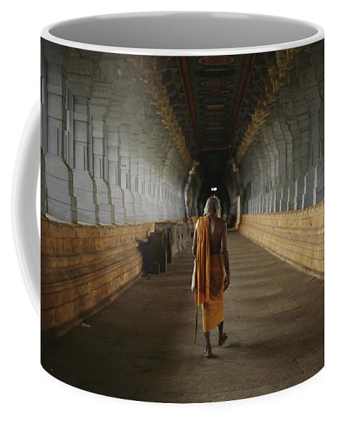 Hindu Clergy Coffee Mug featuring the photograph A Sadu Walks Through Rameswaram Temples by Justin Guariglia
