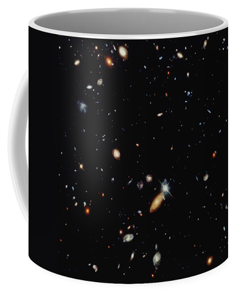 Galaxies Coffee Mug featuring the photograph A Shot Of A Deep Space Photograph by Norbert Rosing
