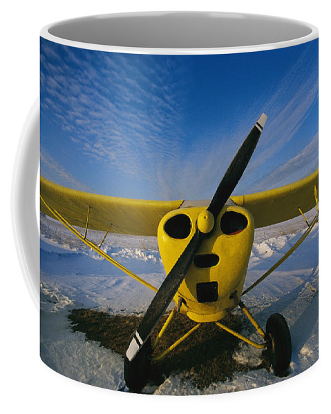 Aircraft Coffee Mug featuring the photograph A Small Personal Aircraft Sitting by Heather Perry