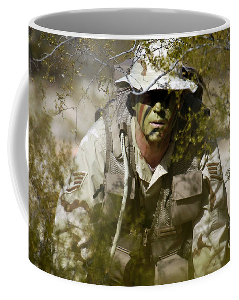 Horizontal Coffee Mug featuring the photograph A Soldier Practices Evasion Maneuvers by Stocktrek Images