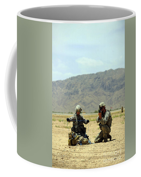 Operation Enduring Freedom Coffee Mug featuring the photograph A Soldier Prepares A Drag Line While An by Stocktrek Images