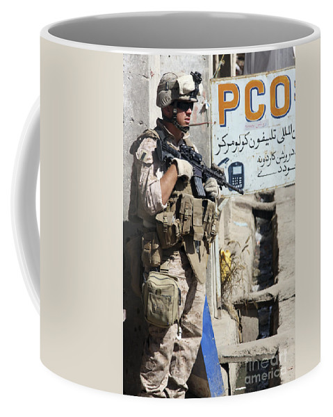Sangin Coffee Mug featuring the photograph A Soldier Provides Security by Stocktrek Images
