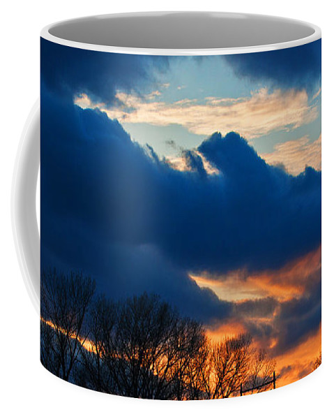 Heron Haven Coffee Mug featuring the photograph A Spring Sunset by Edward Peterson