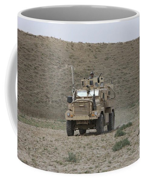 Mrap Coffee Mug featuring the photograph A U.s. Army Cougar Patrols A Wadi by Terry Moore