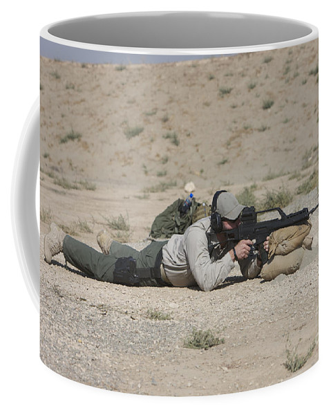 Contractor Coffee Mug featuring the photograph A U.s. Contractor Sights In A German by Terry Moore