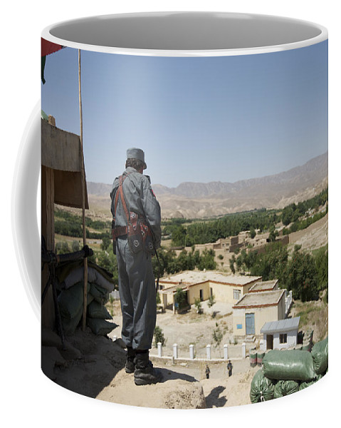 Afghanistan Coffee Mug featuring the photograph Afghan Policeman Standing by Terry Moore