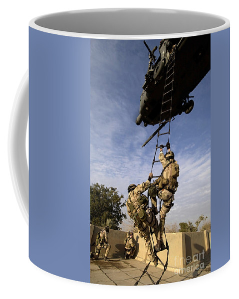 Color Image Coffee Mug featuring the photograph Air Force Pararescuemen Are Extracted by Stocktrek Images