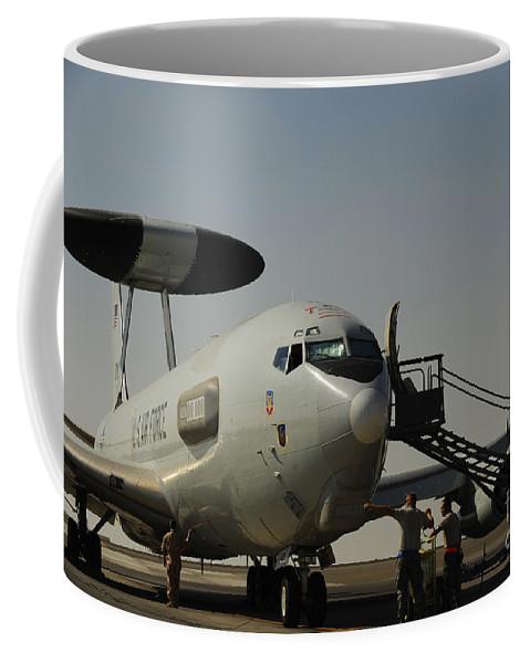 Us Air Force Coffee Mug featuring the photograph Airmen Prepare A U.s. Air Force E-3 by Stocktrek Images