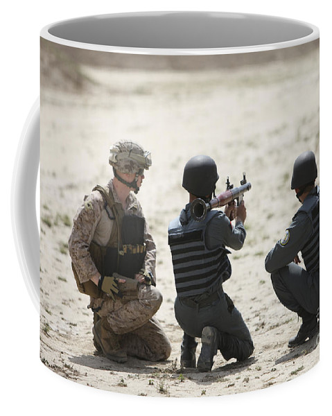Afghanistan Coffee Mug featuring the photograph An Afghan Police Student Prepares by Terry Moore