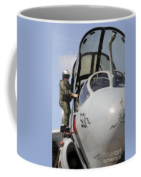 Ea-6b Prowler Coffee Mug featuring the photograph An Airman Makes A Final Look Over An by Stocktrek Images