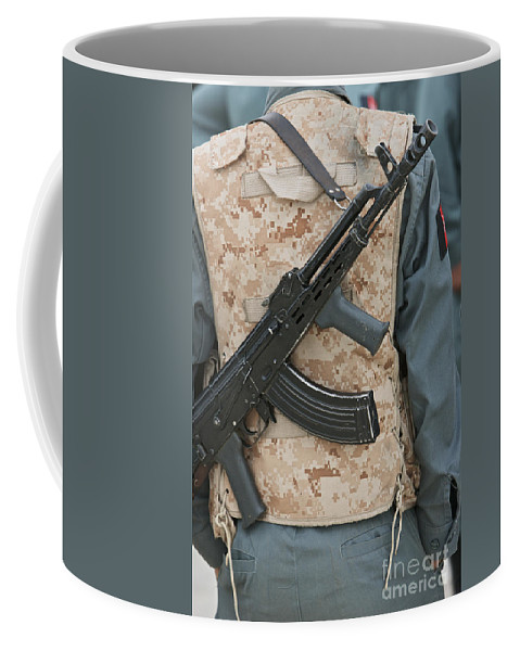 Gun Coffee Mug featuring the photograph An Ak-47 Rests On The Sling Of An by Terry Moore
