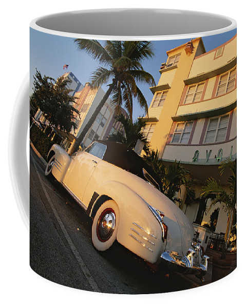 North America Coffee Mug featuring the photograph An Antique Car Parked Outside The Art by Annie Griffiths