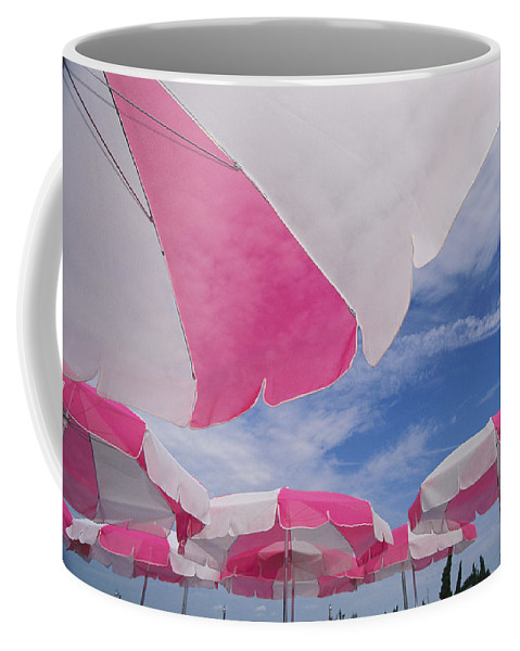 Umbrellas Coffee Mug featuring the photograph An Arrangement Of Pink And White Beach by Clarita Berger