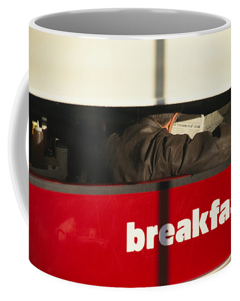 Outdoors Coffee Mug featuring the photograph An Early Morning Diner Reads The Paper by Stephen St. John